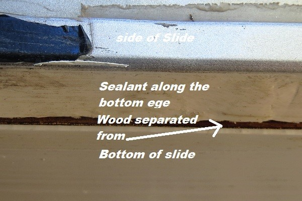 Here is a close up of the slide bottom and the 1″ caulk line that tries to protect it.
