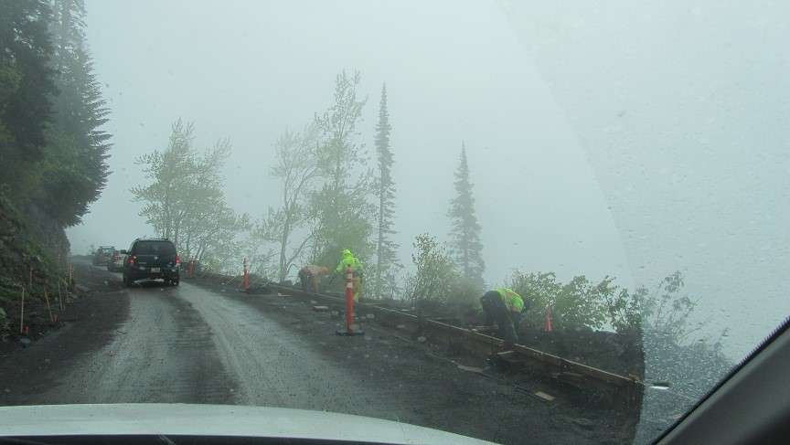 Construction guys have to work on the cliff edge. I guess its lucky for them no one can see over the cliffs.