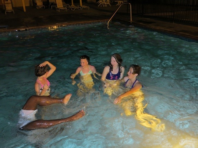 The girls, made friends and brought them in the pool with them.