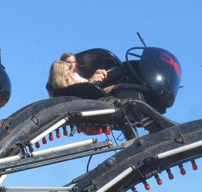 Holly and Sarah ride the Black Widow. Hailey stayed behind, she was sure she was not interested in this one yet.