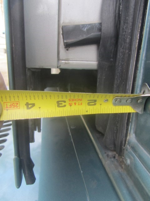 First thing we do today, is open up the doors to expose the gear track, and measure the distance the slide is from the wall of the RV.