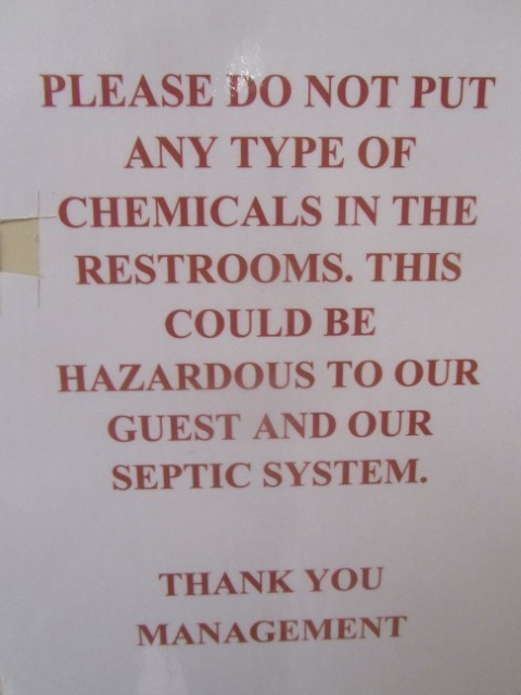 "Hear at the park, we find this new sign in the restroom. This is one of those signs that make you go ""Huh!""  Do they really mean all chemicals?  If so, no one can use the can."
