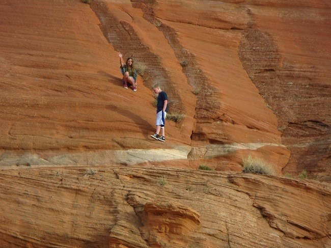 Seth and  Sarah are noticing that one can walk up sandstone cliffs. That is soooo cooool!