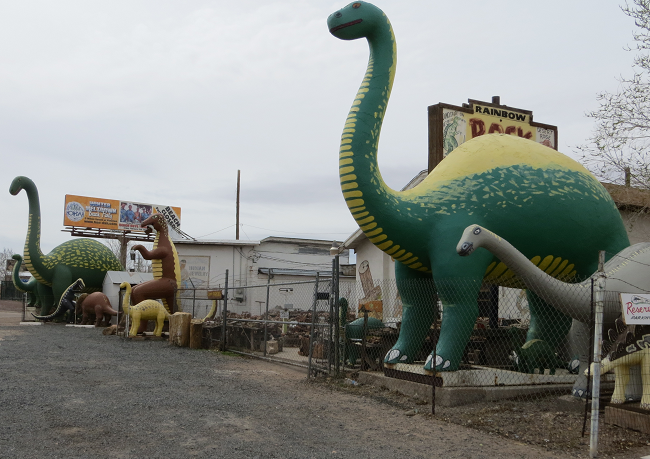 "I did not see these in ""cars"", but they are everywhere along route 66.   The Dinosaur manufacturer must have been turning these out by the train load in 1950."