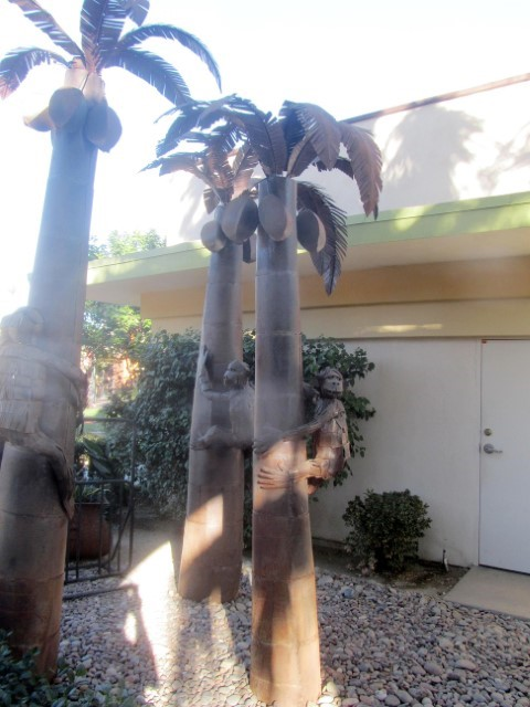 The Palm springs area loves to make water features, and is so proud of palm trees, they make emergency back up ones made of metal. I am not sure what the monkeys are for though.