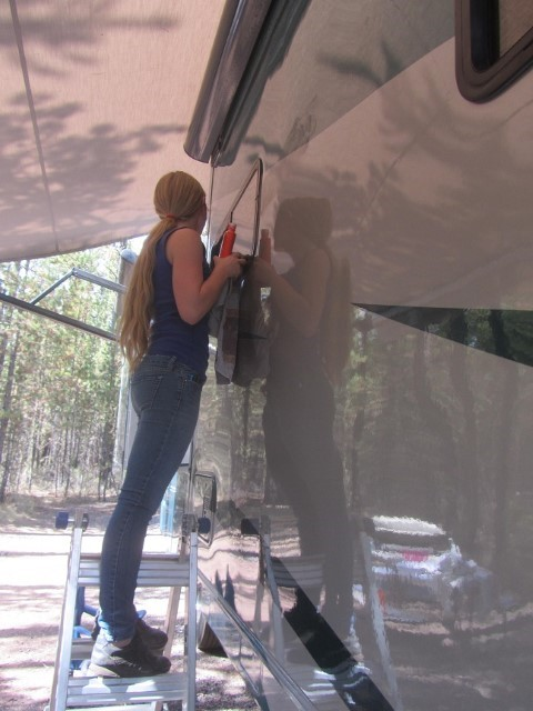 Holly is placing nu-finish. It polishes the RV and is supposed to protect it for a year. Since we expose this rig to many harsh climates we put it on each fall and spring.