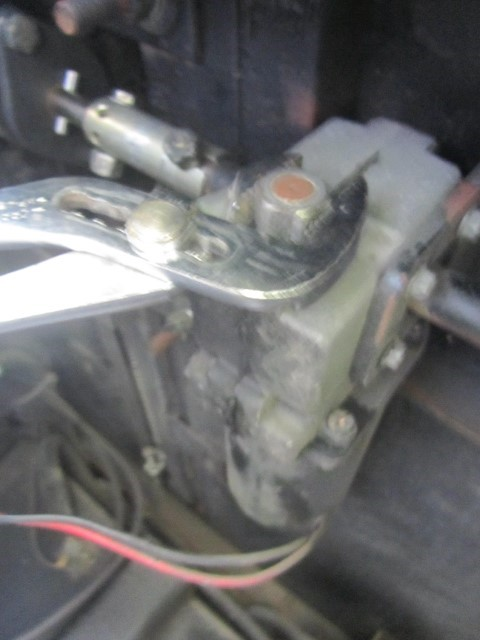 Once the coupler is bolted into place, take the channel locks, and twist the nut on the front of the motor until the motor shaft hole lines up with the slot on the coupler. Place your final 7/19″ bolt through the hole and tighten it into place.  Once everything is bolted down, remove the screw drivers holding the slide up. The last step is optional, but after Athena got in there and replaced the gear pack and put all these pieces back together I used the channel clocks and twisted that nut until the slide ran all the way in, then all the way out. I did this because I could look at and listen to it while it very slowly creeps in and out. What I was looking for was anything that felt like it was binding up the slide, and listening for any unusual sounds. Doing this by hand, would allow me to detect a problem and stop the movement before something would break, The motor is fast and powerful, the slide would be broken in an instant, and we would be back to square one, if something were to be in there still binding the mechanism.  In checking for the objects binding the slide, we found and removed a wayward makeup case lid. We found it by running our fingers under slide before I cranked it in. One last note about the Holiday Rambler Ambassador slides, the owners manual says if the slides ever get stuck out, go out side and push them in and lock them in place with a stick wedged against the wall and the slide trim. Unless your 6'8′ and 700 pounds of solid man meat, you are not pushing these slides in to travel position. First, try cranking the nut on the end of the motor, that will bring your slide in if the failure is in the motor, or electrical. If the problem is the gears inside the motor, right behind that nut, disconnect the bolt in the coupler so it can spin free of the motor. If the problem is like ours, and you need to move the rig, your best bet is what we have seem others do, get a friend with a pickup truck to drive up to the slide, and gently push the slide in place and lock it down with a stick on the inside.  These slides need a vehicle, or a team of humans to move them back in when they are broken. The owners manual makes it much easier than it is. One guy I spoke with, took his jack from his car, placed it against the wall inside his RV, and against the inside slide trim and moved it that way, but I do not recommend it, it seems the RV wall could be at risk. If repairing the slide on site, or humans and Vehicles are not a choice, it is time to call road side assistance to get you to a repair center.