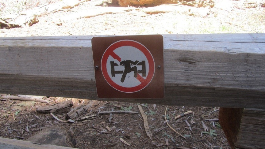 I guess it is risky to climb General Sherman fence! The guy in the sign is missing his head.