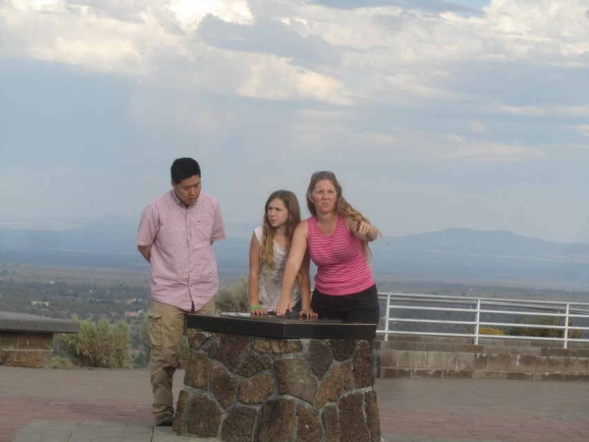 They are looking at map of the mountain on Pilot butte in Bend