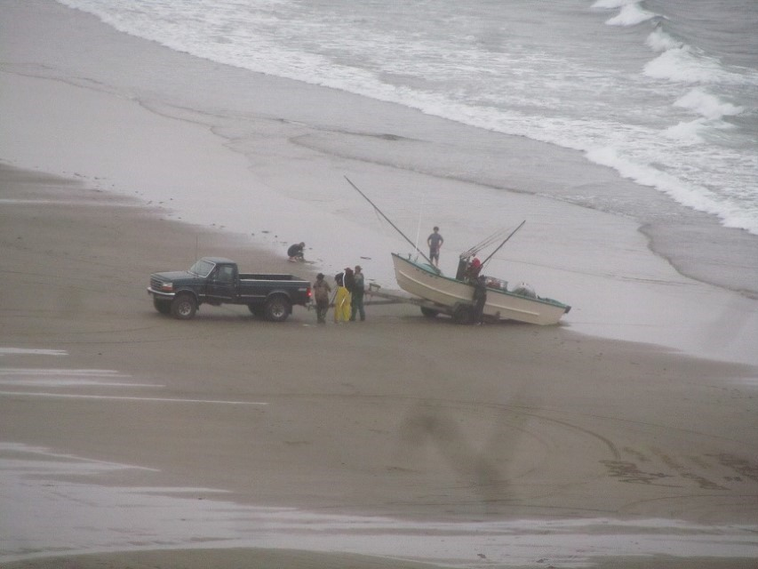 The trailer tips like a dump truck, the boat, is then cranked via a winch on to the trailer.