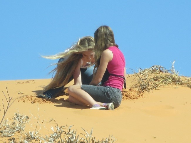 Holly and Sarah dig a hole in the top of the dune, turns out there is moisture in the dune.