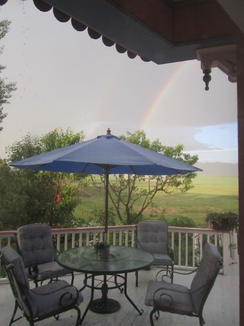 Well the fun is over, and we are left with a beautiful rain bow over the back deck.