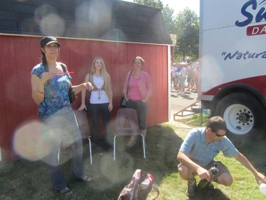 My crew enjoying the shade while finishing their ice cream. Anyone know how to buy and replace a lens on a Cannon SX210? Love the camera, but the lens is a disaster.