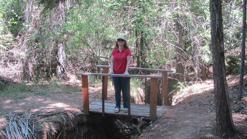 My beautiful wife posing for me on the foot bridge. I asked her to do this so we would know if the old bridge was safe to walk on.